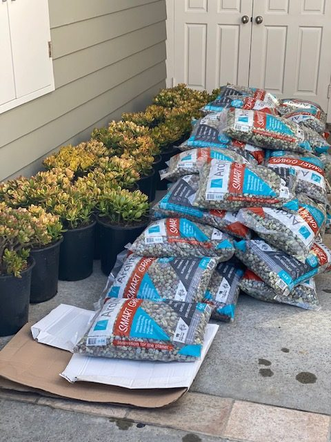 The Backyard installing pots with Smart Gravel